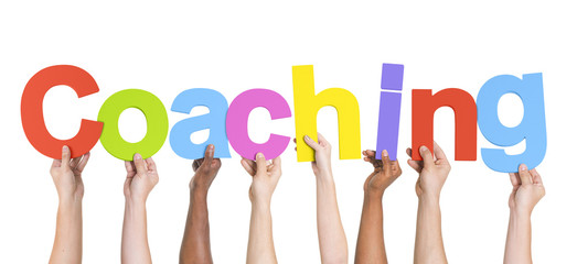 Diverse Hands Holding The Word Coaching