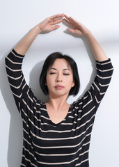 beautiful middle aged woman yoga posing on a studio