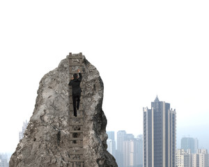 Businessman climbing to top of rocky mountain with city backgrou