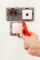 Changing a defective electrical wall fixture