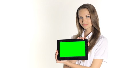 Beautiful girl shows information from the tablet on a white