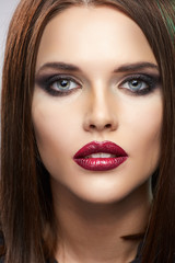 Close up beauty portrait. Red lips.