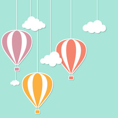 Hot air baloons and clouds in paper cutout style