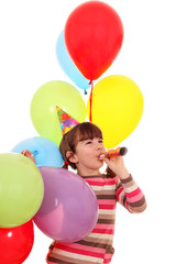 happy little girl with trumpet and balloons birthday