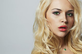 young woman with beautiful healthy face. Curly blond hair