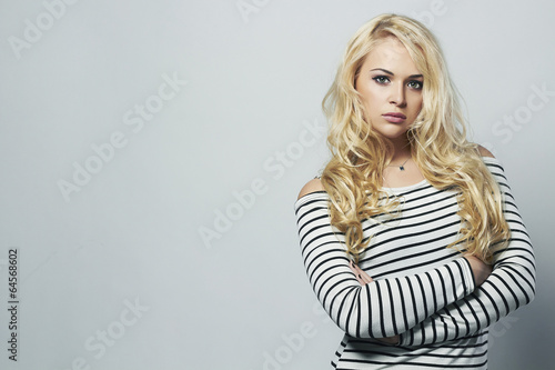 Beautiful blond woman in dress. Curly hair. Beauty Girl. sailor