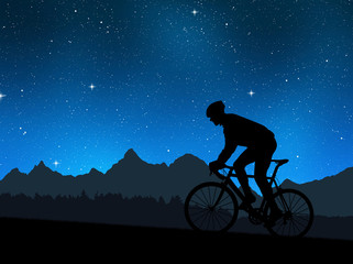 silhouette of the cyclist riding a road bike in night
