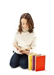 Little girl reading book on white background