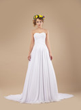 Espousal. Bride with Wreath of Flowers in White Dress