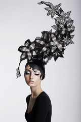 Fantasy. Surrealism. Woman in Trendy Headwear with Flowers