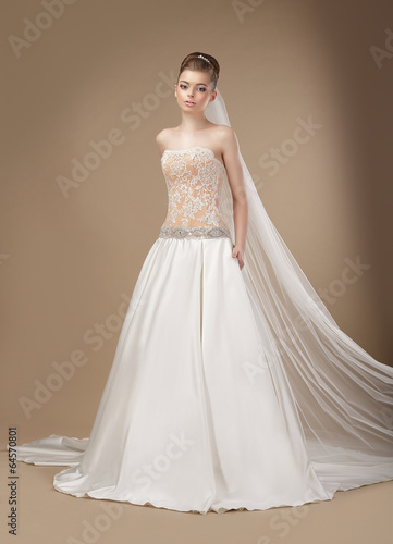 Luxury. Elegant Classy Brunette in Ivory Light Dress