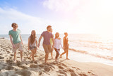 Multiracial Group of Friends Walking at Beach - Fine Art prints