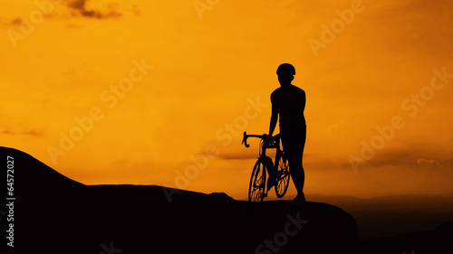 Man and bicycle on mountain