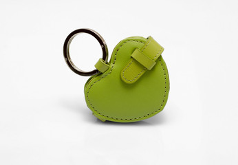 Green leather trinket isolated on white