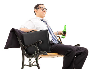 Businessman chilling out with a beer