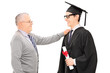 Father congratulates his son for graduating