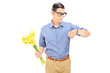Man holding flowers and checking the time