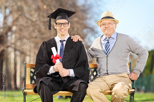 Proud son and father posing in park