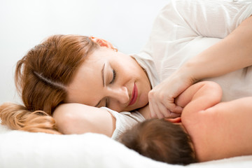 happy mom breast feeding newborn baby