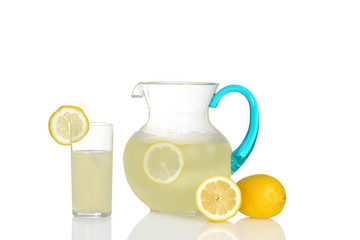 glass of lemonade with pitcher