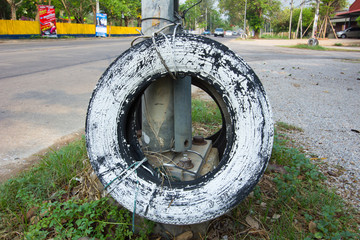 used car tire painted in white used for car accident protection