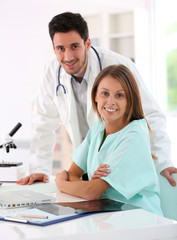 Doctor with nurse working together