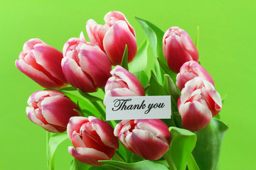 Thank you card with pink tulips on green background