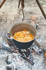 Cooking pilaf on campfire