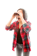 Young woman looking through binoculars and shock