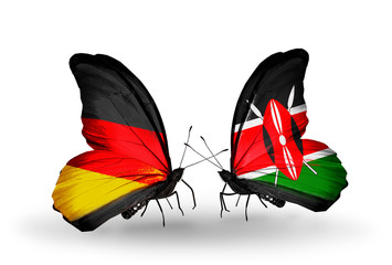 Two butterflies with flags Germany and Kenia