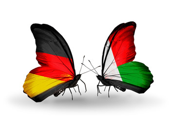 Two butterflies with flags Germany and Madagascar