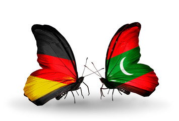 Two butterflies with flags Germany and Maldives