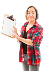 Young woman showing clipboard