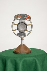 Old microphone on air sign