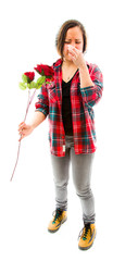 Young woman pinches her nose with holding rose