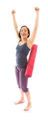 Young woman carrying exercise mat celebrating success