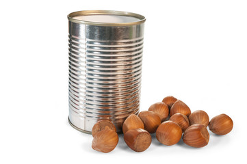Group of delicious hazel nut in a small tin can