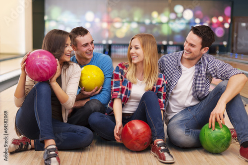 Young group of friends have fun at bowling alley