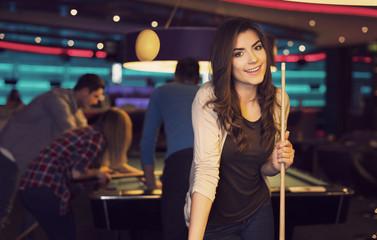 Portrait of smiling woman in billiard club