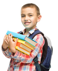 Cute boy is holding book