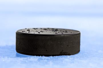 puck on blue ice