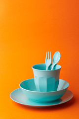 Blue props on orange background