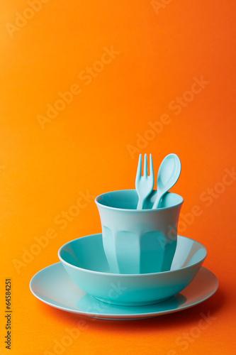 Blue props on orange background