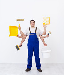 Multitasking worker ready to paint the room