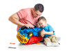 kid boy and his dad repair toy trunk