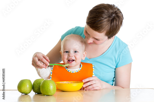 baby eating healthy food with mother