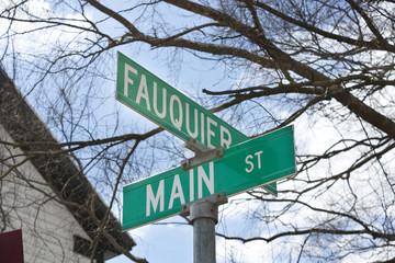 "A street sign that says, ""Fauquier"" and ""Main"""