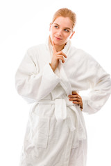 Young woman standing in bathrobe with hand on hip