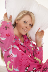 woman pink pajamas pillow behind head