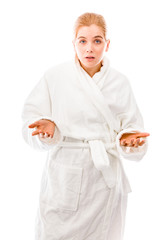 Young woman standing in bathrobe and don't know what to do isola